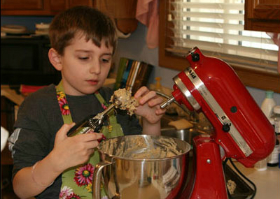 Boy using a food mixer in the kitchen
